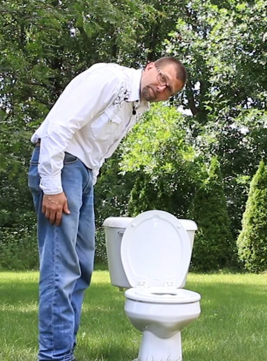 Tim in yard with Toilet